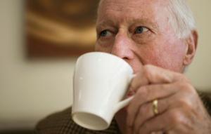 Elderly man drinking coffee