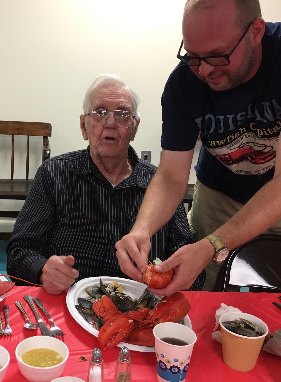 Salt Air Senior enjoys a lobster dinner