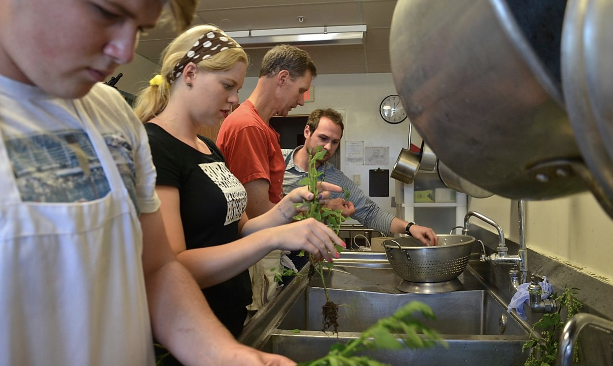 Students learn cooking in the kitchen